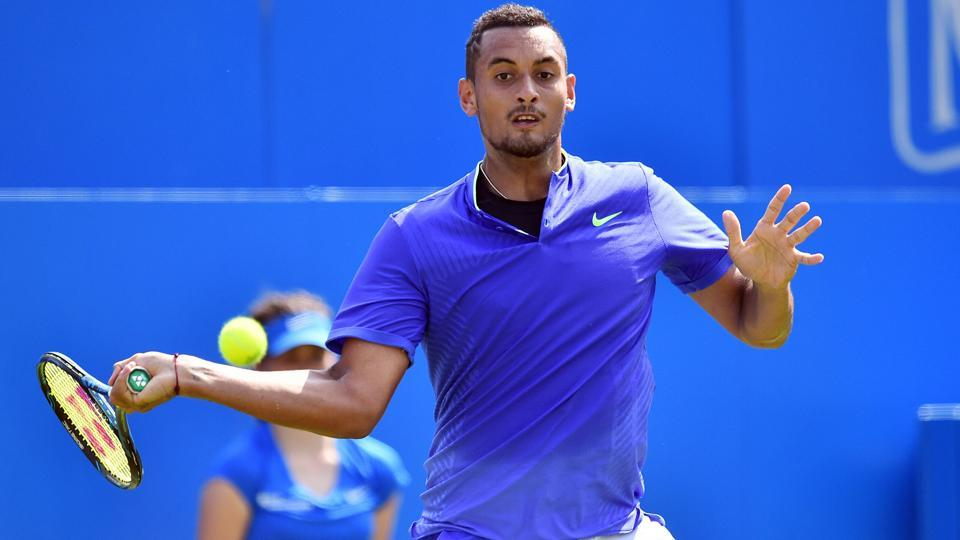 Australia's Nick Kyrgios returns to Donald Young in their men's singles 1st round match at the Queen's Club Championships.