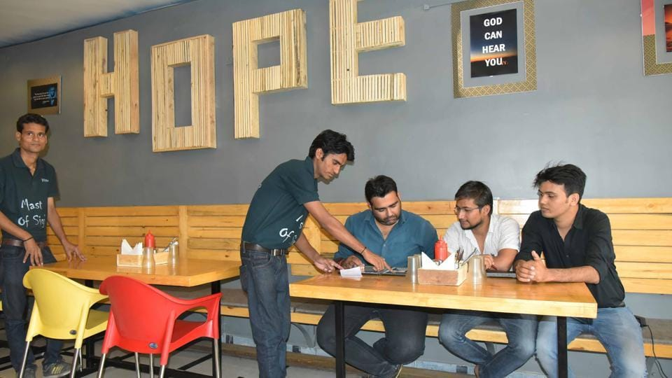 Hearing impaired waiters serve at the eatery in Jaipur.