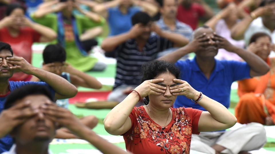 People perform yoga at Lodhi Garden in New Delhi in preparation for the International Yoga Day on June 21, 2017.