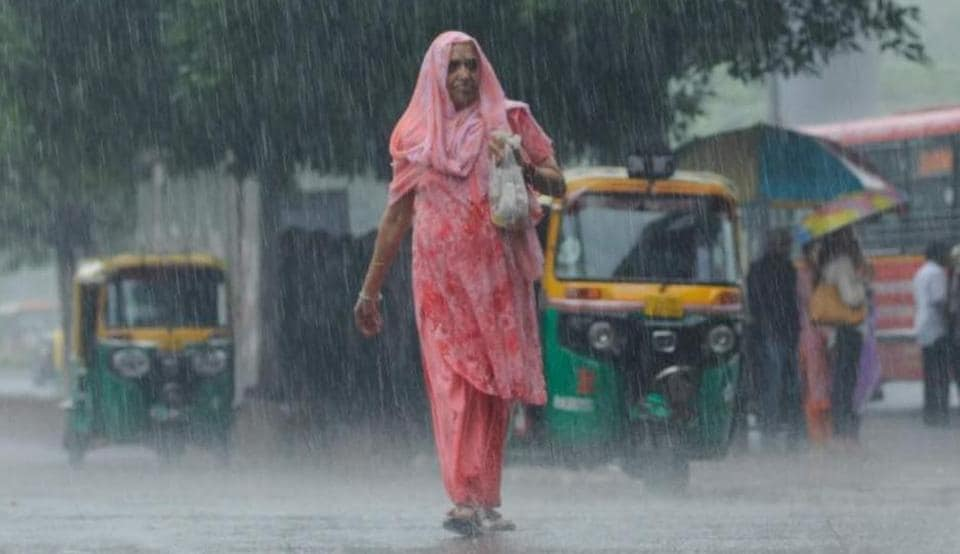 Heavy rains brought the temperatures down to a pleasant 23 degree Celsius in Delhi.