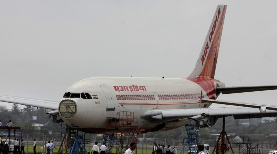 An Air India aircraft undergoes routine maintenance at the airline's hanger inside the Mumbai airport.