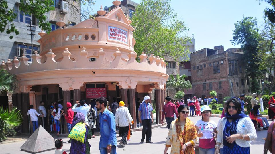 Visitors at Amritsar's Jallianwala Bagh that saw a massacre on Sunday, April 13, 1919, Amritsar.