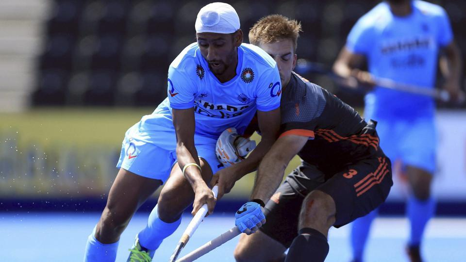 India's Mandeep Singh, left, and Netherlands Tristan Algera battle for the ball during the FIH Hockey World League.