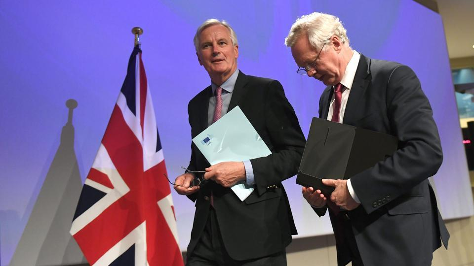 British Secretary of State for Exiting the European Union (Brexit Minister) David Davis (R) and European Commission member in charge of Brexit negotiations with Britain, Michel Barnier leave after addressing a press conference at the end of the first day of Brexit negotiations at the European Commission in Brussels on June 19, 2017.