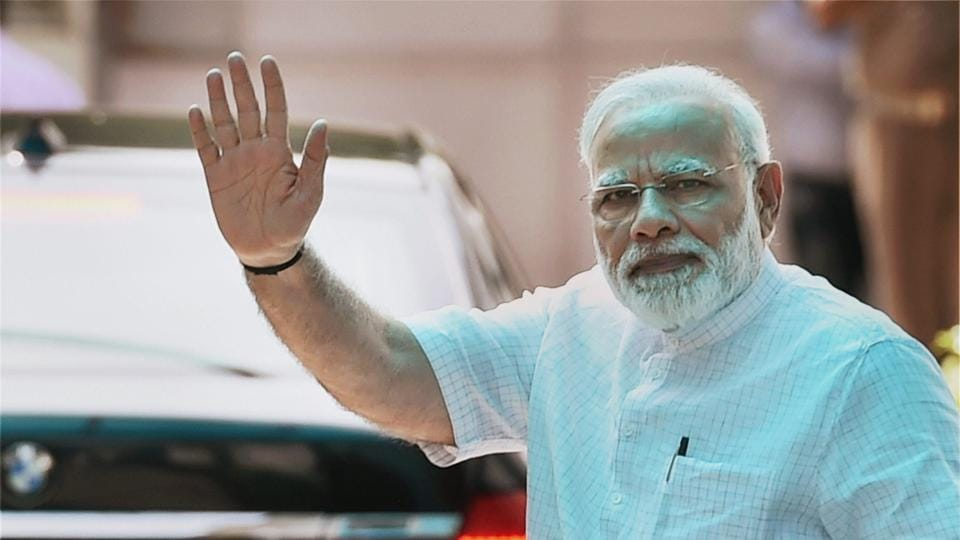Prime Minister Narendra Modi waves after BJP Parliamentary Board meeting to announce their Presidential candidate in New Delhi on Monday.