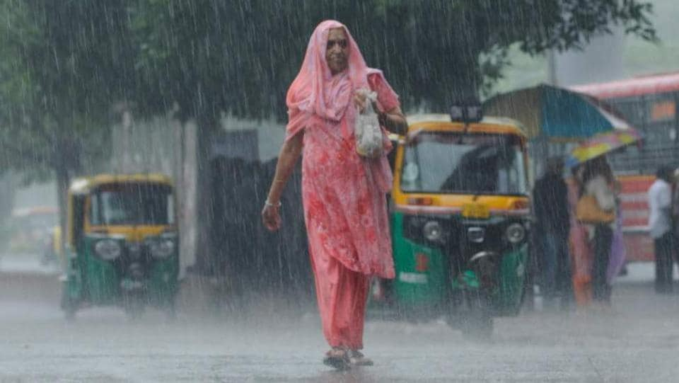 An elderly woman walks during heavy rains on June 2 New Delhi. The capital received 26.4mm of rain in the past 24 hours, the highest single day downpour observed in June since 2013. The MeT office has said more rain is expected in the coming days as Western disturbances hit the city. This welcome respite from the heat of past weeks also brought with it longer commutes for motorists in the morning and waterlogging at several locations across the city. (Burhaan Kinu/HTPhoto)