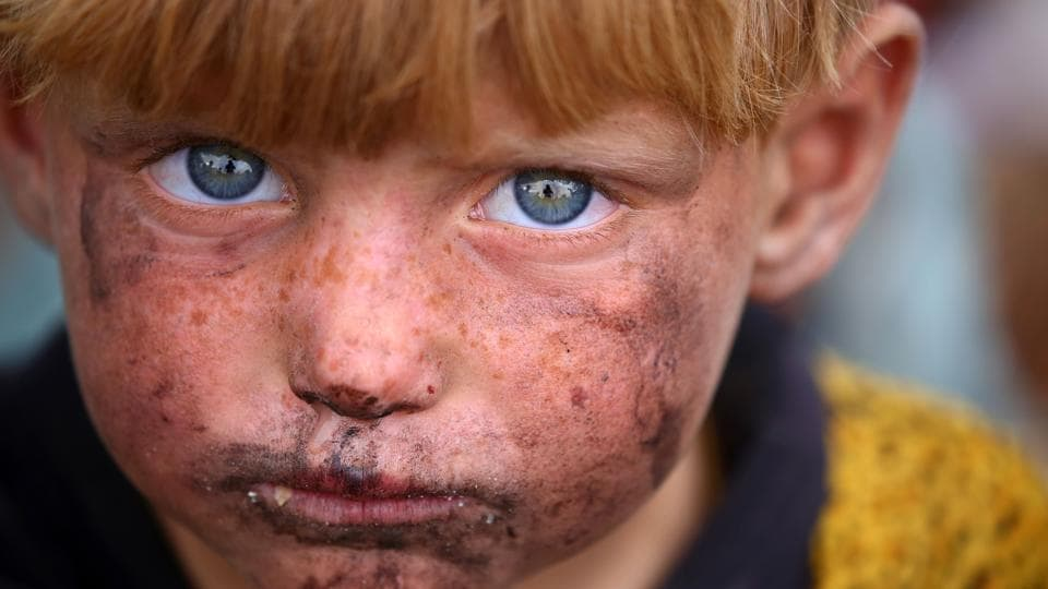 A displaced Syrian child who fled the countryside surrounding the Islamic State (IS) group stronghold of Raqa, at a temporary camp in the village of Ain Issa.  (AFP)