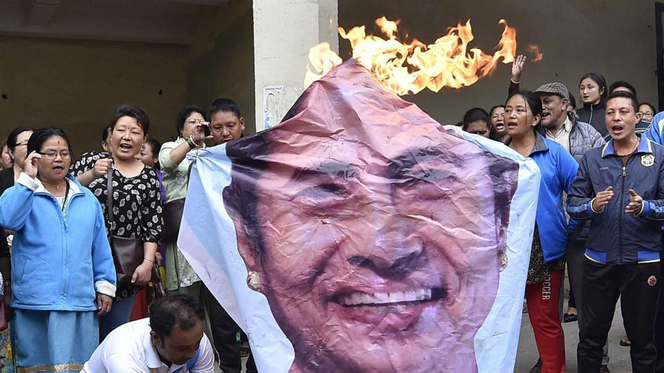 GJM supporters in Darjeeling burn an effigy of West Bengal Chief Minister Mamata Banerjee on Monday.