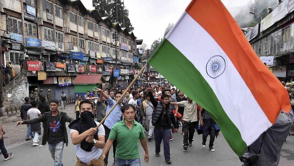 GJM supporters wave a Tricolour during a protest rally in Darjeeling on Sunday.