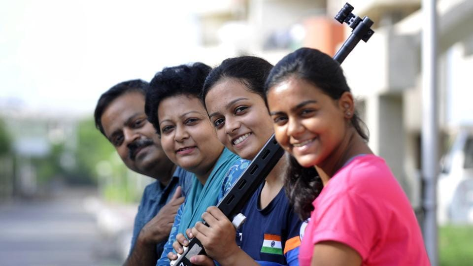 Shreya Saksena (holding a rifle) with her family in Greater Noida.