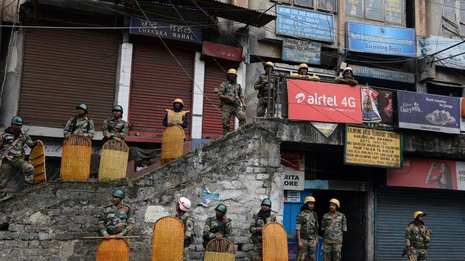Police guard stores in Darjeeling following clashes with Gorkha Janmukti Morcha (GJM)  this week.