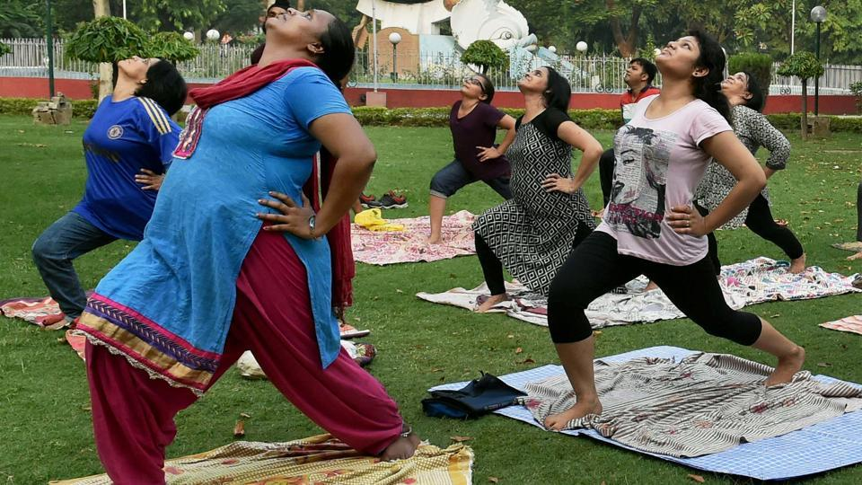 People practice yoga at a park in Lucknow, Uttar Pradesh on June 18, 2017. (Nand Kumar/PTI)