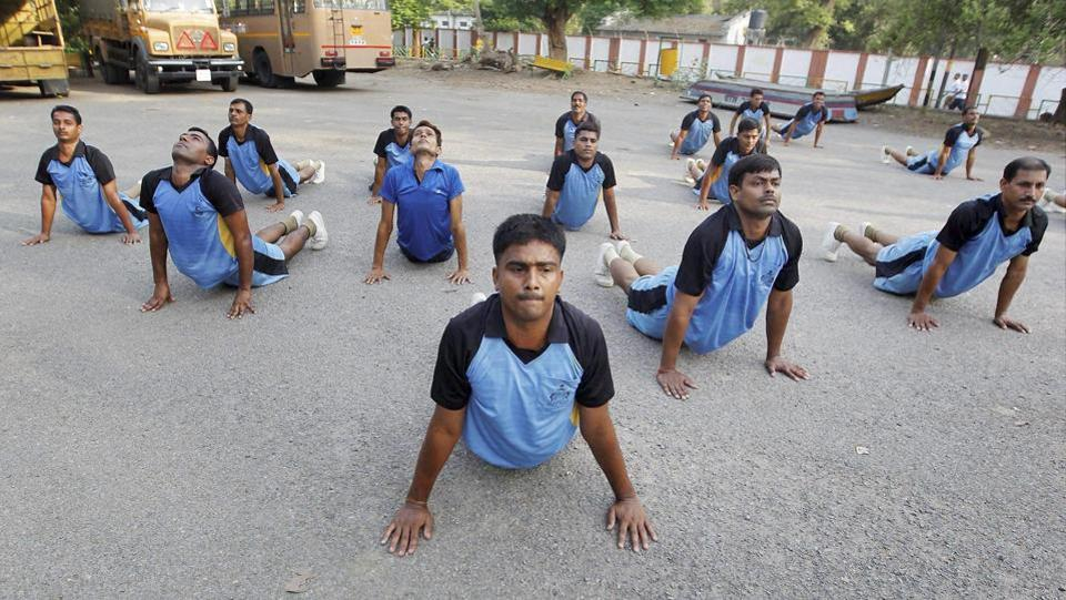 Provincial Armed Constabulary javans perform yoga on the banks of Yamuna river in Allahabad, Uttar Pradesh on June 14, 2017. (PTI)
