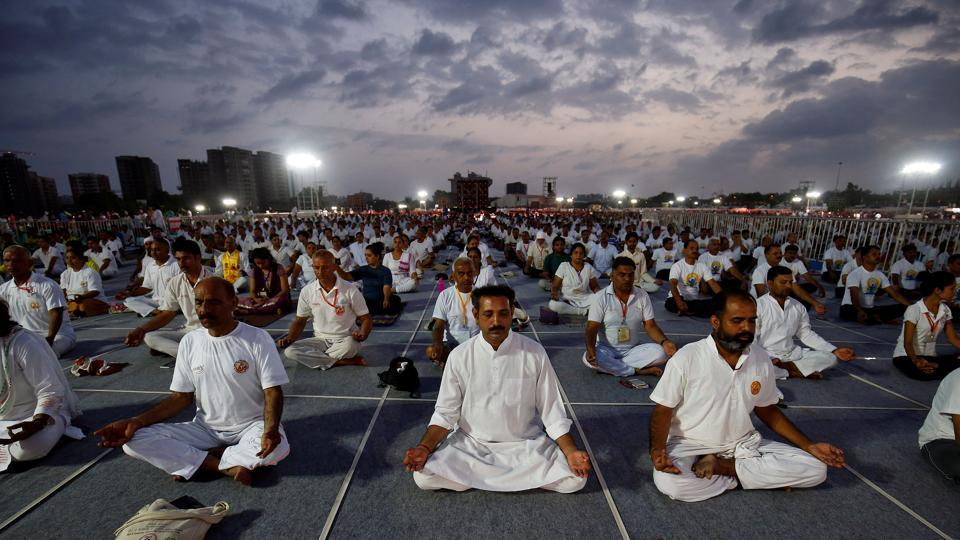People perform yoga during a four-day long camp by yoga guru Baba Ramdev ahead of International Yoga day in Ahmedabad.