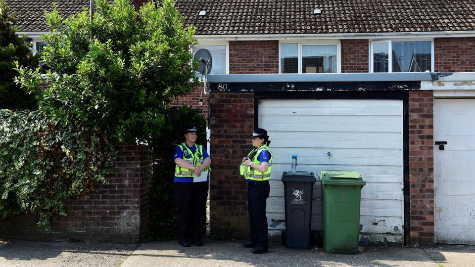 Police officers stand outside the home of Darren Osborne in Cardiff, Wales, on June 20, 2017. Osborne was named by British media as the man suspected of driving a rented van into worshippers after they left prayers at a north London mosque.