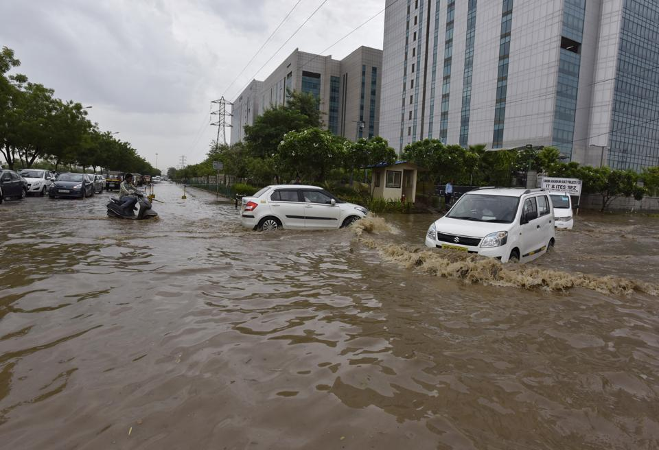 Waterlogging was a common sight at several spots in Gurgaon after the heavy downpour in Delhi- NCR on Monday morning.