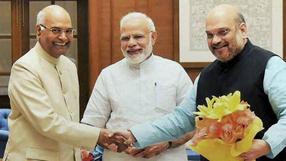 Prime Minister Narenda Modi and BJP chief Amit Shah with NDA's presidential nominee and Bihar Governor Ram Nath Kovind in New Delhi on June 19, 2017.