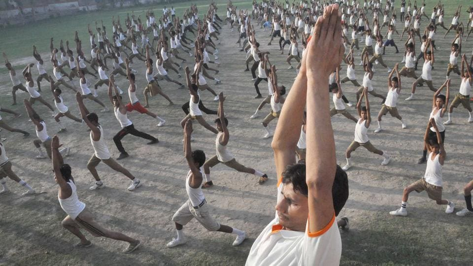 Children take part in a mass yoga session at a camp organised at a school ahead of International Yoga Day in Moradabad, Uttar Pradesh on June 13, 2017.  (PTI)