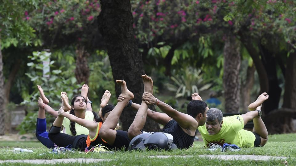 A group strikes a yoga pose at Lodhi Garden in New Delhi on June 18, 2017. (Arvind Yadav/HT Photo)