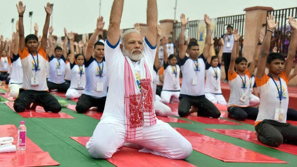 Prime Minister Narendra Modi performs yoga during the International Yoga Day in Lucknow on Wednesday.