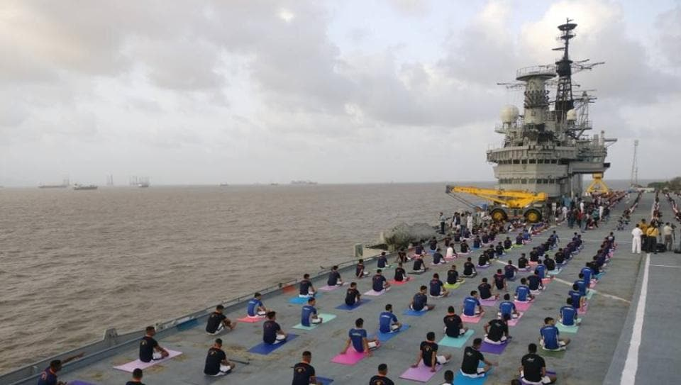Indian Naval Cadets perform yoga on the deck of INS Virat on the eve of International Yoga Day in Mumbai.