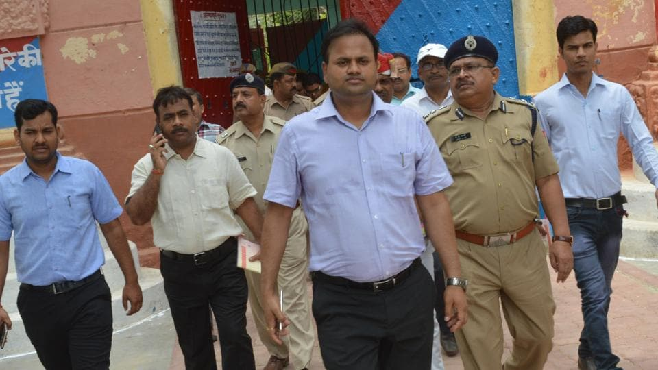 DM Ravindra Kumar  along with officials at Fatehgarh Jail.