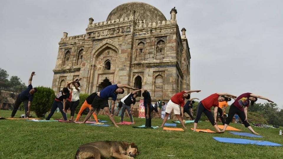 People perform yoga on International Yoga Day at Lodhi garden in New Delhi. (Arvind Yadav/HT Photo)