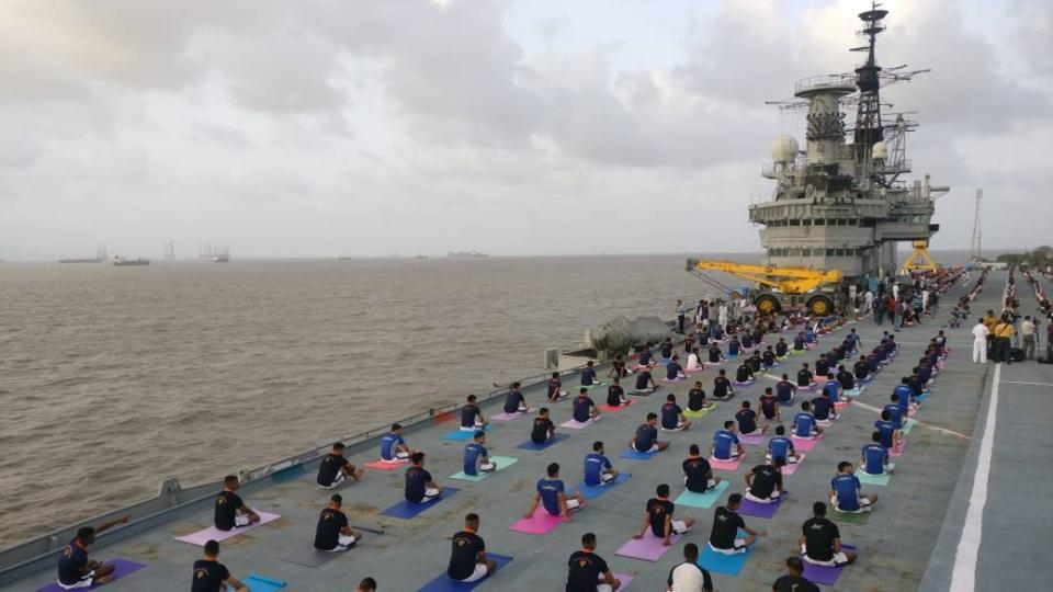 Indian Naval Cadets perform yoga on the deck of INS Virat on International Yoga Day in Mumbai, Maharashtra. Large scale yoga sessions have people across India bending and twisting into various poses on International Day of Yoga. Here's a look in pictures. (Pratik Chorge/HT Photo)