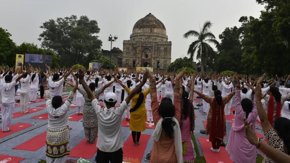 People take part in Yoga Day celebrations at Lodhi Gardens in New Delhi.