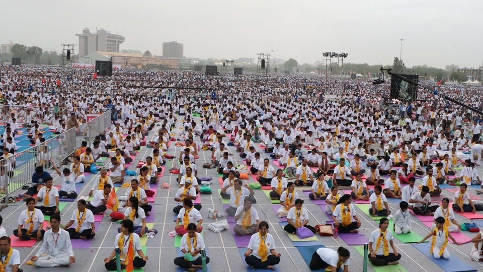 BJP President Amit Shah and Yoga Guru Baba Ramdev during International Yoga day celebration in Ahmedabad in Gujarat, on June 21, 2017.