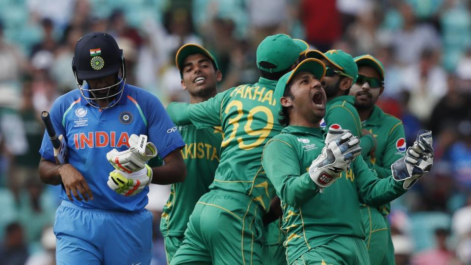 Pakistan's captain Sarfraz Ahmed, right, celebrates the dismissal of India's Ravichandran Ashwin, left, during the ICC Champions Trophy final at The Oval in London, Sunday, June 18, 2017.
