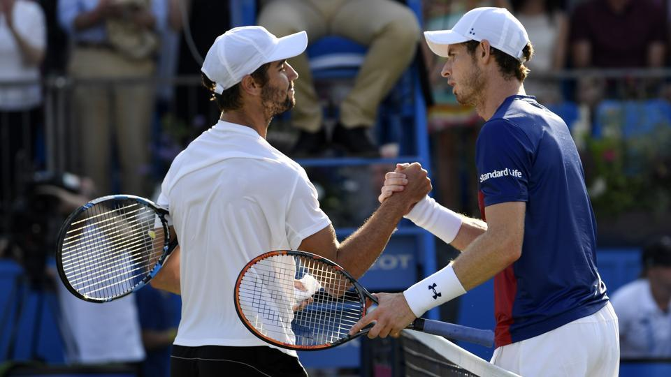 Australia's Jordan Thompson shakes the hand of Great Britain's Andy Murray after winning their first round match at Aegon Championships in Queen's Club, London.