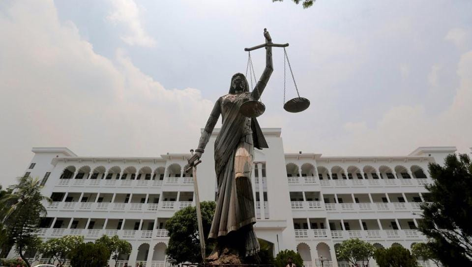 The statue of Lady Justice stands after it was reinstalled near the Supreme Court complex in Dhaka, Bangladesh, May 28