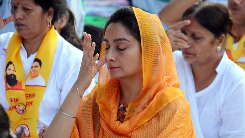 Union food processing  minister Harsimrat Kaur Badal performing Anulom Vilom Pranayam at a yoga event in Bathinda.  (Sanjeev Kumar/HT)