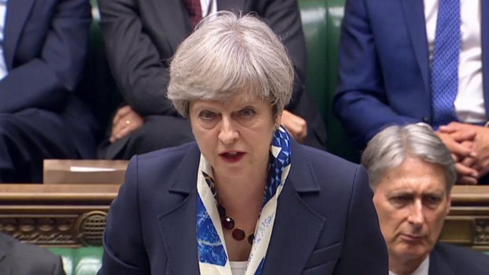 A video grab from footage broadcast by the UK Parliament's Parliamentary Recording Unit (PRU) shows Britain's Prime Minister Theresa May as she speaks in the House of Commons in London on June 21, 2017.