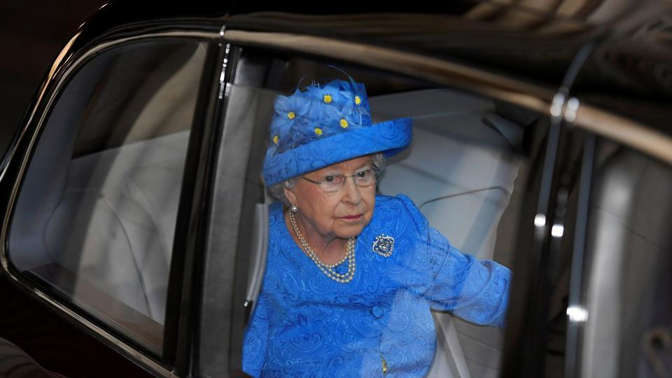 Britain's Queen Elizabeth II leaves by car from the Houses of Parliament in London on June 21, 2017, following the State Opening of Parliament.