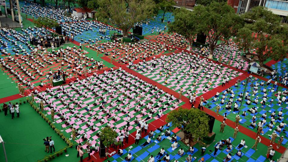 Chandigarh residents taking part in the International Yoga Day celebrations at the Sector 17 Plaza  in Chandigarh on Wednesday morning. (Keshav Singh/HT)
