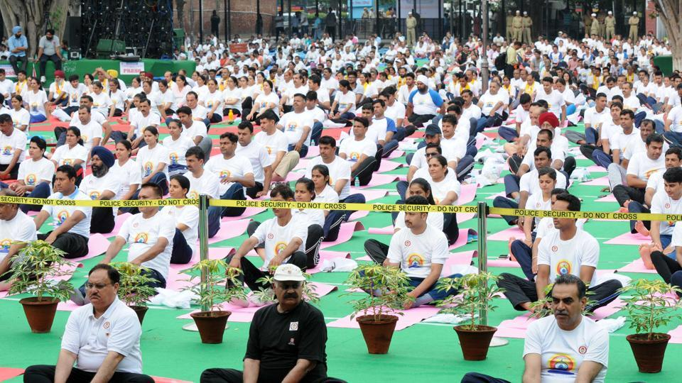 From left: Union health minister JP Nadda , Punjab governor VP Singh Badnore and Chandigarh BJP  chief Sanjay Tandon during the 3rd International Yoga day 2017 at Sector 17 Plaza in Chandigarh on Wednesday.