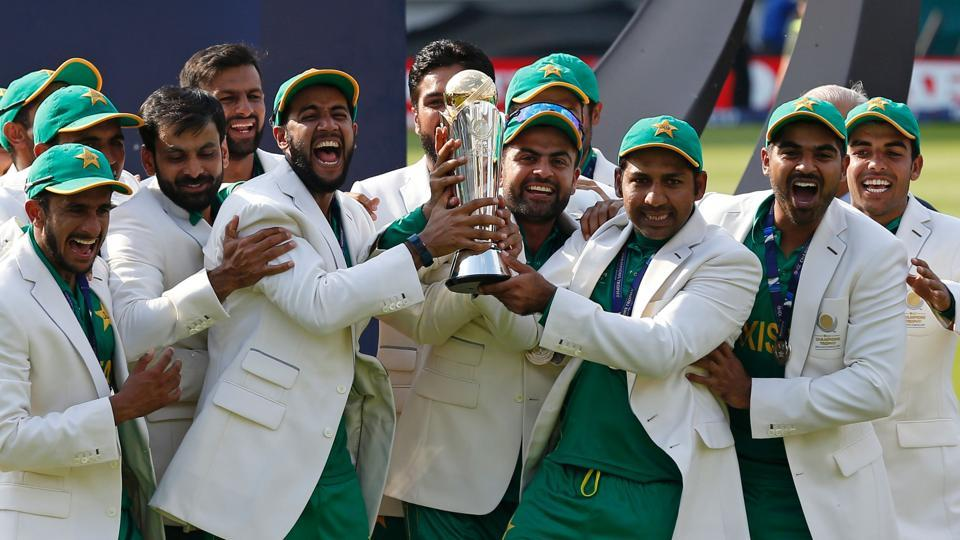 Pakistan's Sarfraz Ahmed holds the trophy as Pakistan players celebrate their win over India in the ICC Champions Trophy final in London on June 18.