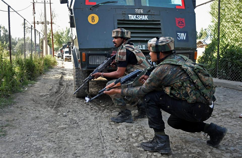 A civilian woman died in a crossfire between security personnel and militants in south Kashmir's Anantnag