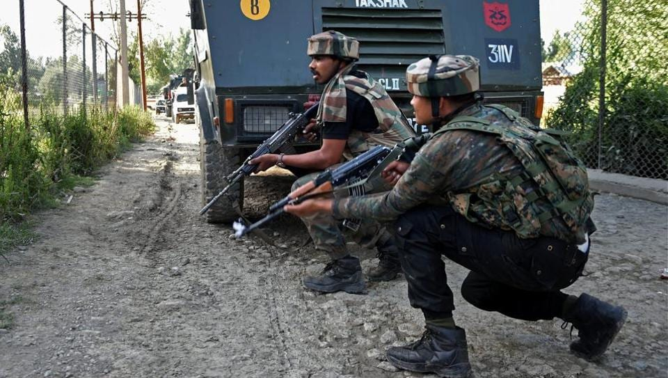 Army jawans take positions during an encounter with militants in Kashmir.