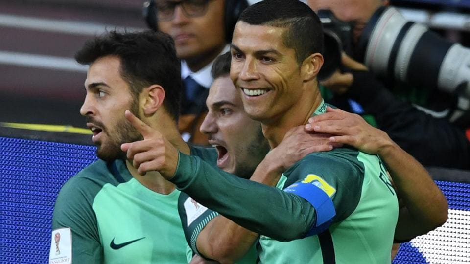 Cristiano Ronaldo (R) celebrates after scoring a goal during the FIFA Confederations Cup match between Russia and Portugal.