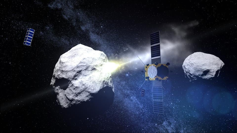 This computer generated handout image taken on May 15, 2015 and released by the European Space Agency (ESA) on May 15, 2015 shows the impact of the DART (Double Asteroid Redirection Test) projectile on the binary asteroid system (65803) Didymos observed by the AIM (Asteroid Impact Mission) satellite.