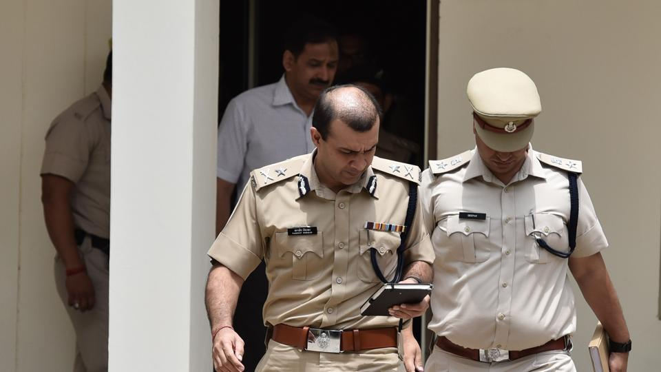 Gurgaon police commissioner Sandeep Khirwar (left) met officers at the Sector 29 police station in Gurgaon on Tuesday.