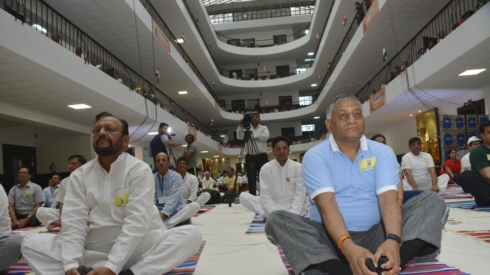 (Right) Union minister and Ghaziabad MP General (retired) V K Singh and Uttar Pradesh minister Suresh Khanna lead the yoga day celebrations at IMS Engineering College in Ghaziabad on Wednesday.