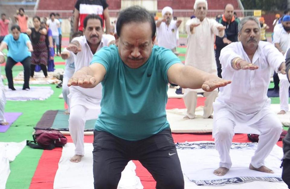 Union science and technology minister Dr Harsh Vardhan doing the Kursi Asana at Guru Nanak Stadium in Amritsar. (Sameer Sehgal/HT)