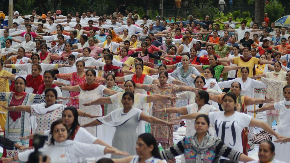 Residents of Ludhiana showing off their yoga moves at Rakh Bagh on International Yoga Day. (Jagtinder Singh Grewal/HT)