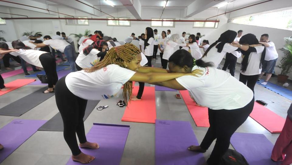 Foreign students from Symbiosis International University perform yoga on the occasion of International Yoga Day in Pune.