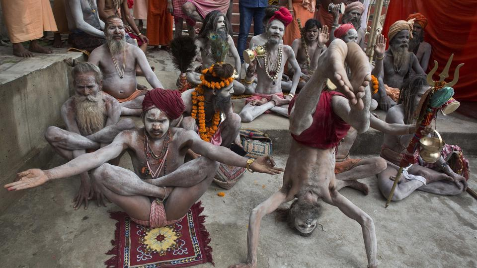 Indian Sadhus or Hindu holy men perform yoga on International Yoga Day at Kamakhya temple in Assam. (Anupam Nath/AP)