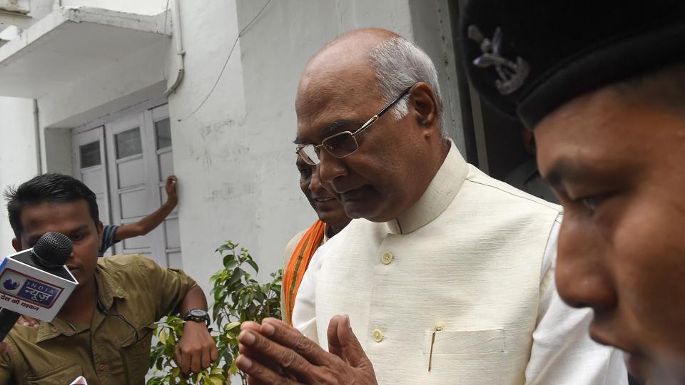 Bihar Governor Ram Nath Kovind (C) gestures as he leaves his residence in New Delhi on June 20, 2017.